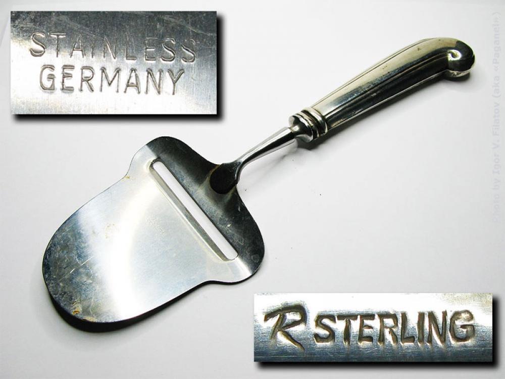 Сырорезка с серебряной рукоятью.